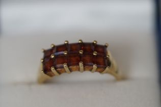 9ct gold ring set with 10 red stones