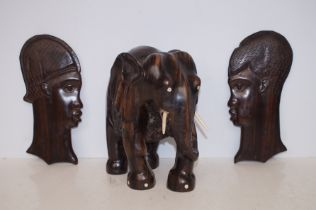 Carved African Elephant possibly Lignum together with Two Carved Wall Masks - Elephant is 27cm h