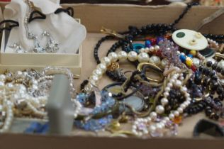 A collection of costume jewellery to include Monet