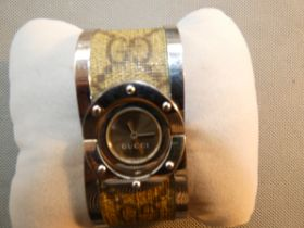 Ladies Gucci watch with spare link original box &