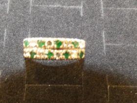 9ct Gold dress ring set with diamonds & green gem