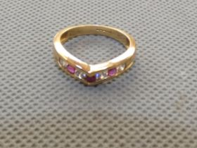 9ct Gold ring set with red & white gem stones Size