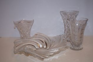 Crystal fruit together with 3 crystal vases
