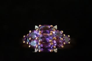 9ct Gold ring set with 9 purple stones