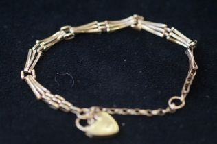 9ct Gold bracelet with safety chain & heart shaped