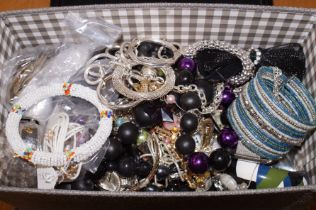 Large box of unsorted costume jewellery