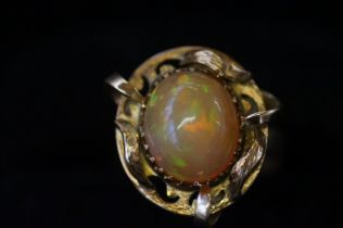 Gold ring, (Hallmark rubbed) set with mystique Opa