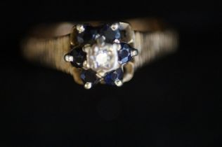 9ct Gold ring set with diamond & sapphire