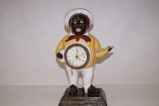 An original ceramic Banjo boy clock 40cm