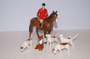Beswick huntsman with fox & 4 hounds