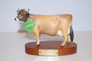 Rare matt jersey cow on wooden plinth boxed