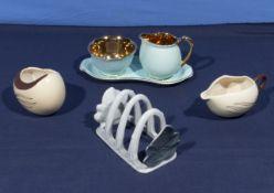 A Carlton Ware cream and sugar and toast rack together with a Crown Devon cream/sugar
