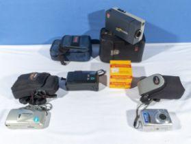A Kodak cine camera, 2 Olympus and one Canon camera