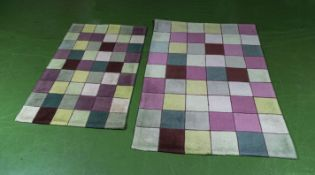 Two chequered rugs, 120cm x 180cm and 90cm x 150cm