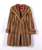 A lady's three quarter length fur coat