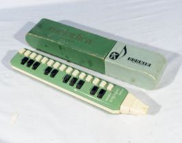 A vintage Hohner Soprano melodica with box