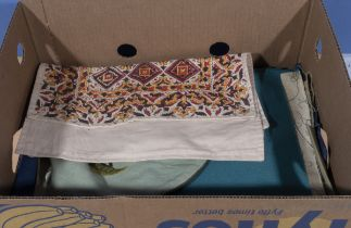A box containing vintage fabrics
