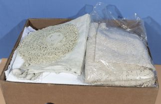 A box of vintage table linen