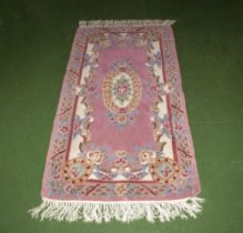 A pink Chinese style rug