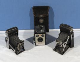 Three vintage Kodak cameras