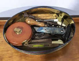 A collection of vintage tools, rules and a tape measure