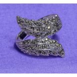 A silver and marcasite ring