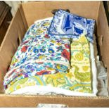 A box containing vintage linen and fabric