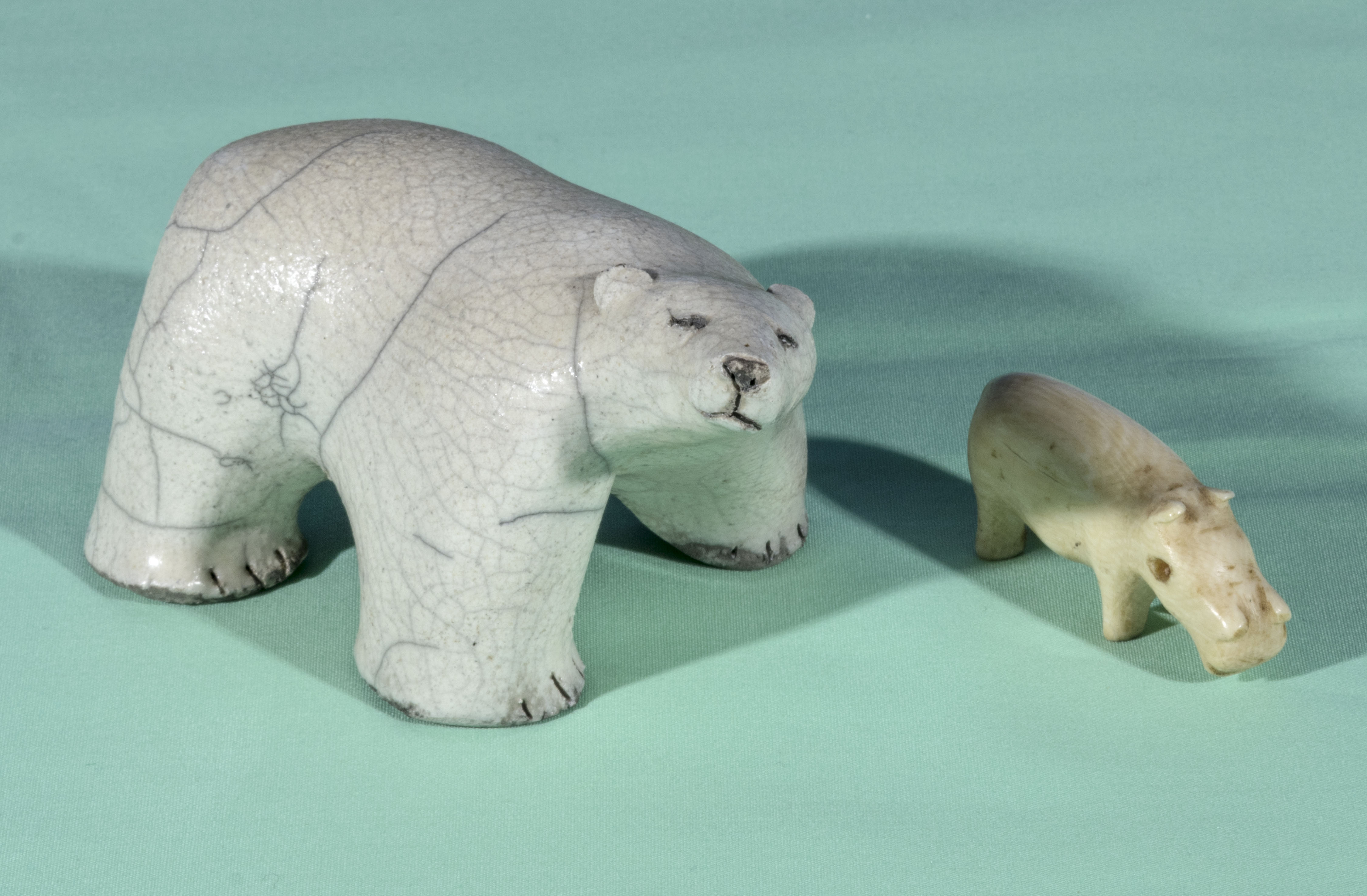 An Inuit polar bear and one other carving