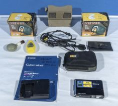 A Sony Cyber shot DSC T70 digital camera and accessories together with a viewmaster and two other