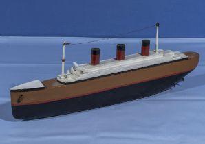 A small model of an ocean liner 40cm long