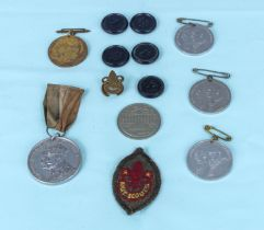 Five Preston Guild medals and four tram tokens