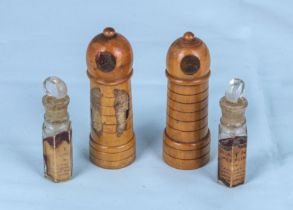 A pair of antique treen scent bottle holders with screw tops and bottles