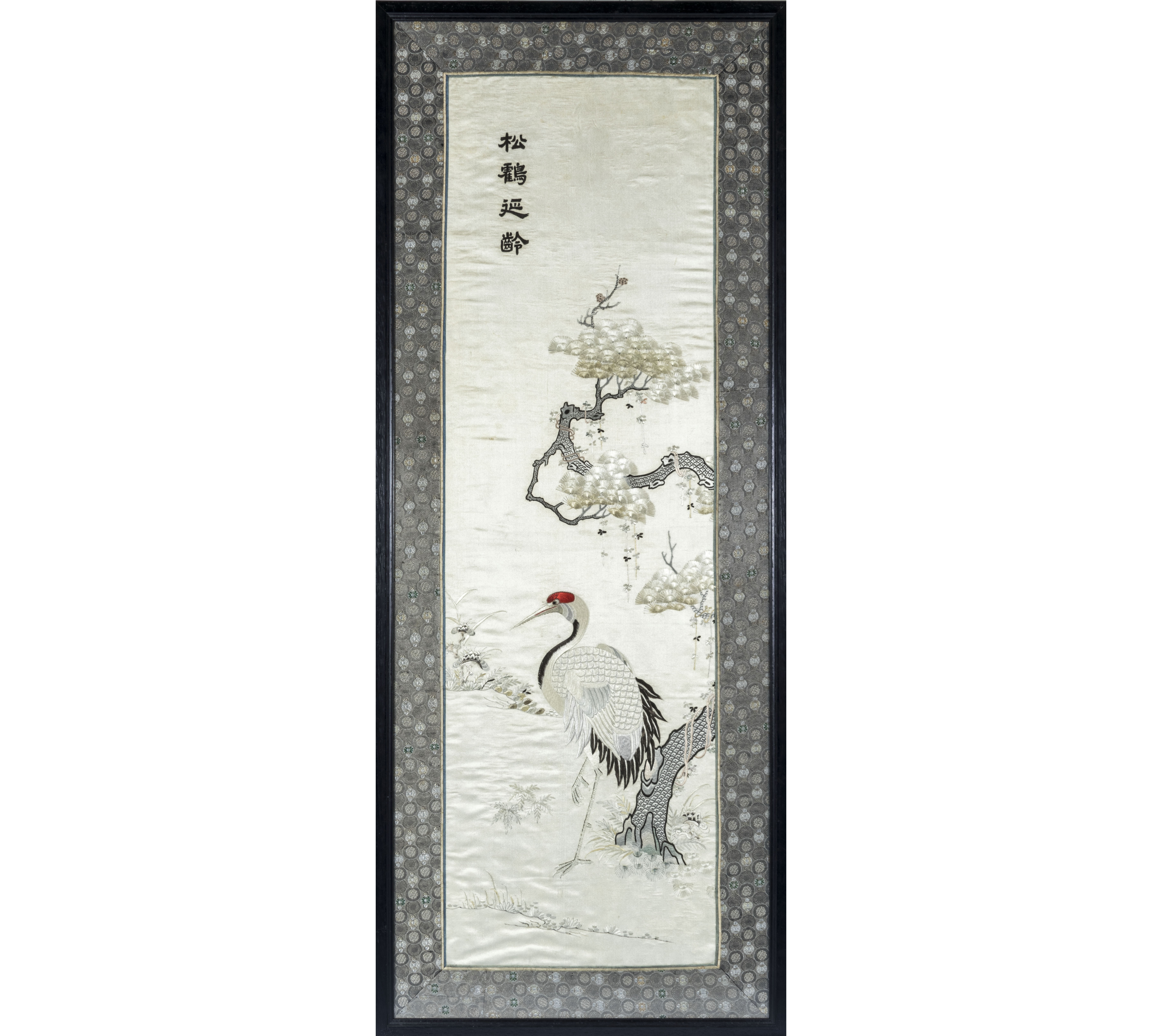 A framed Chinese silk scroll embroidered with 110cm x 40cm