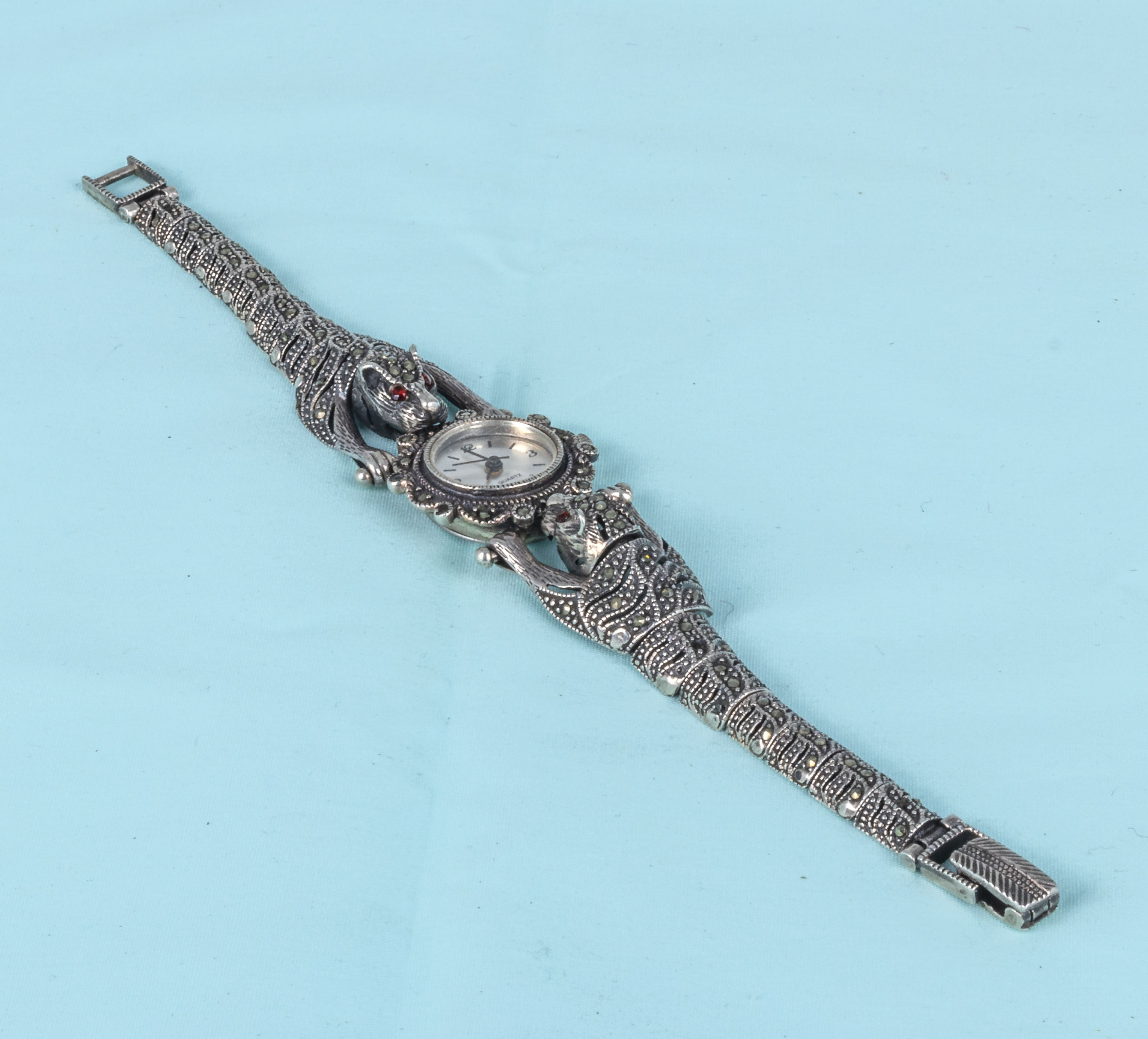A lady's French marcasite and silver dress wristwatch with leopard shoulders