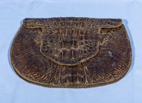 A vintage crocodile skin purse