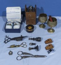 A collection of vintage items including candle snuffers, grape scissors, seals and others