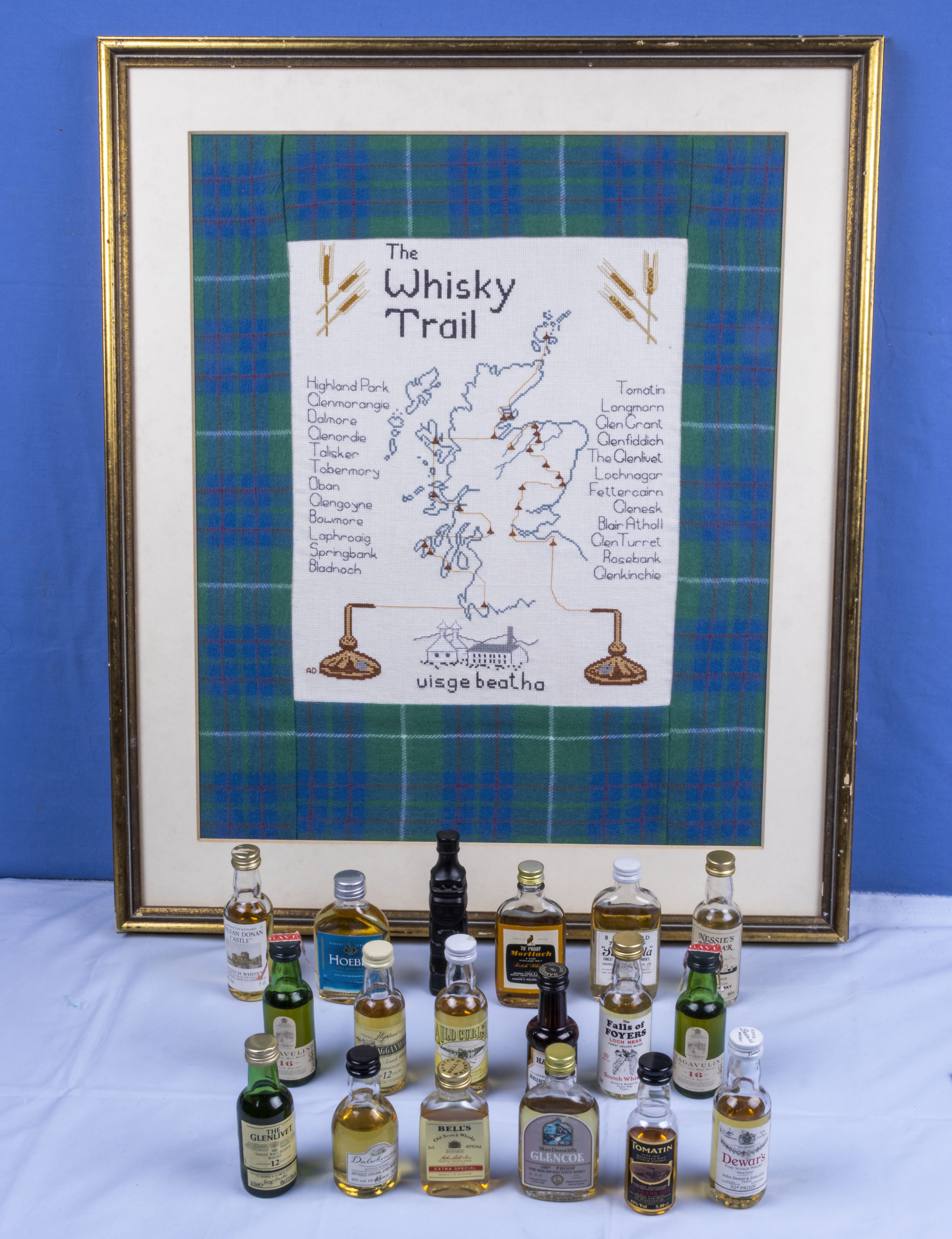 A framed Scottish Whisky Trail embroidery together with a collection of whisky miniatures