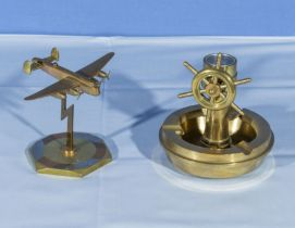 A brass bomber aeroplane desk decoration together with a brass nautical ash tray