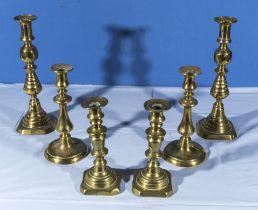 Three pairs of brass candlesticks