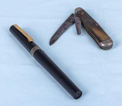 A vintage Osmiroid fountain pen and a horn pocket knife