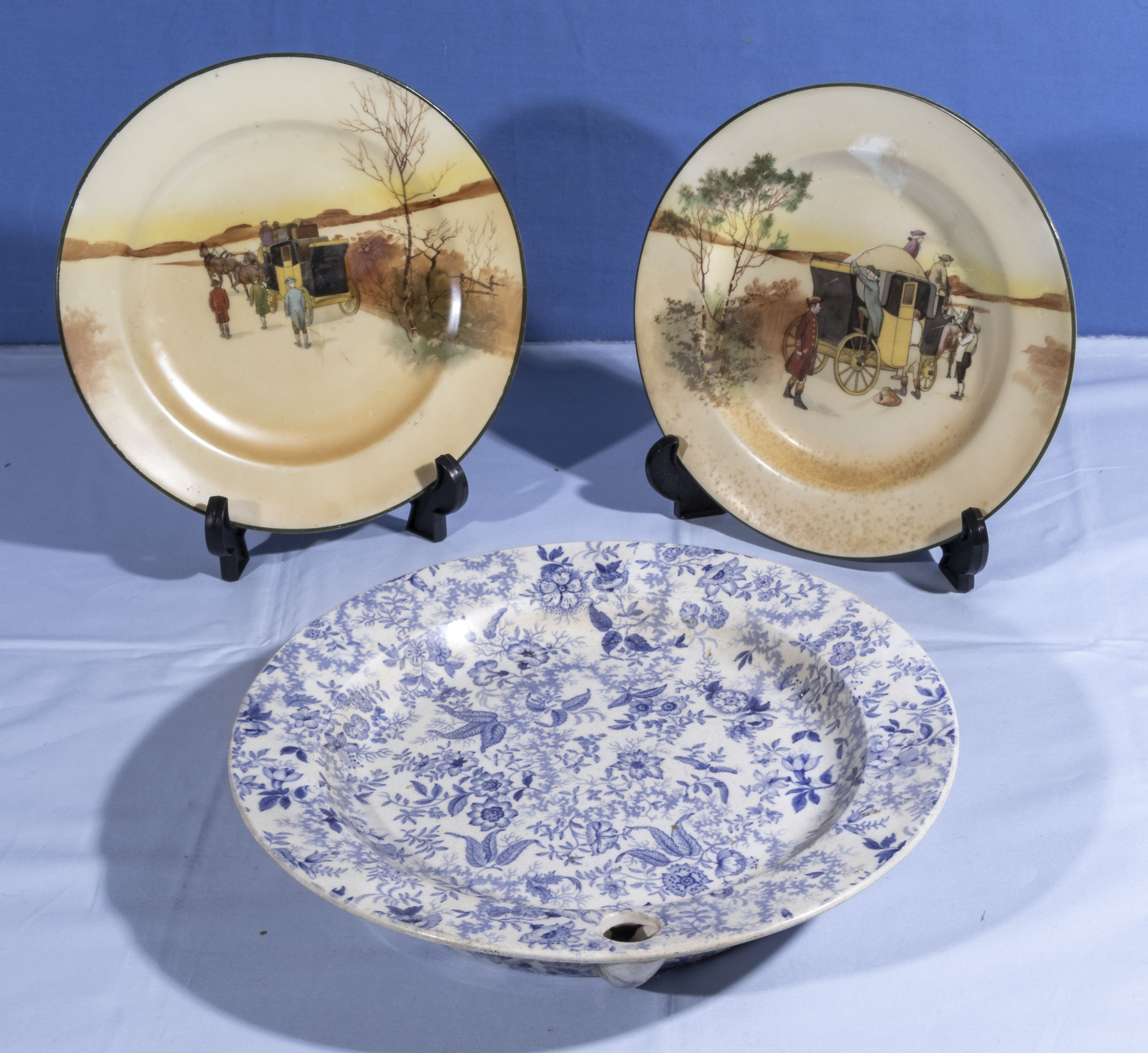 A pair of Doulton plates together with a blue and white printed hot water plate