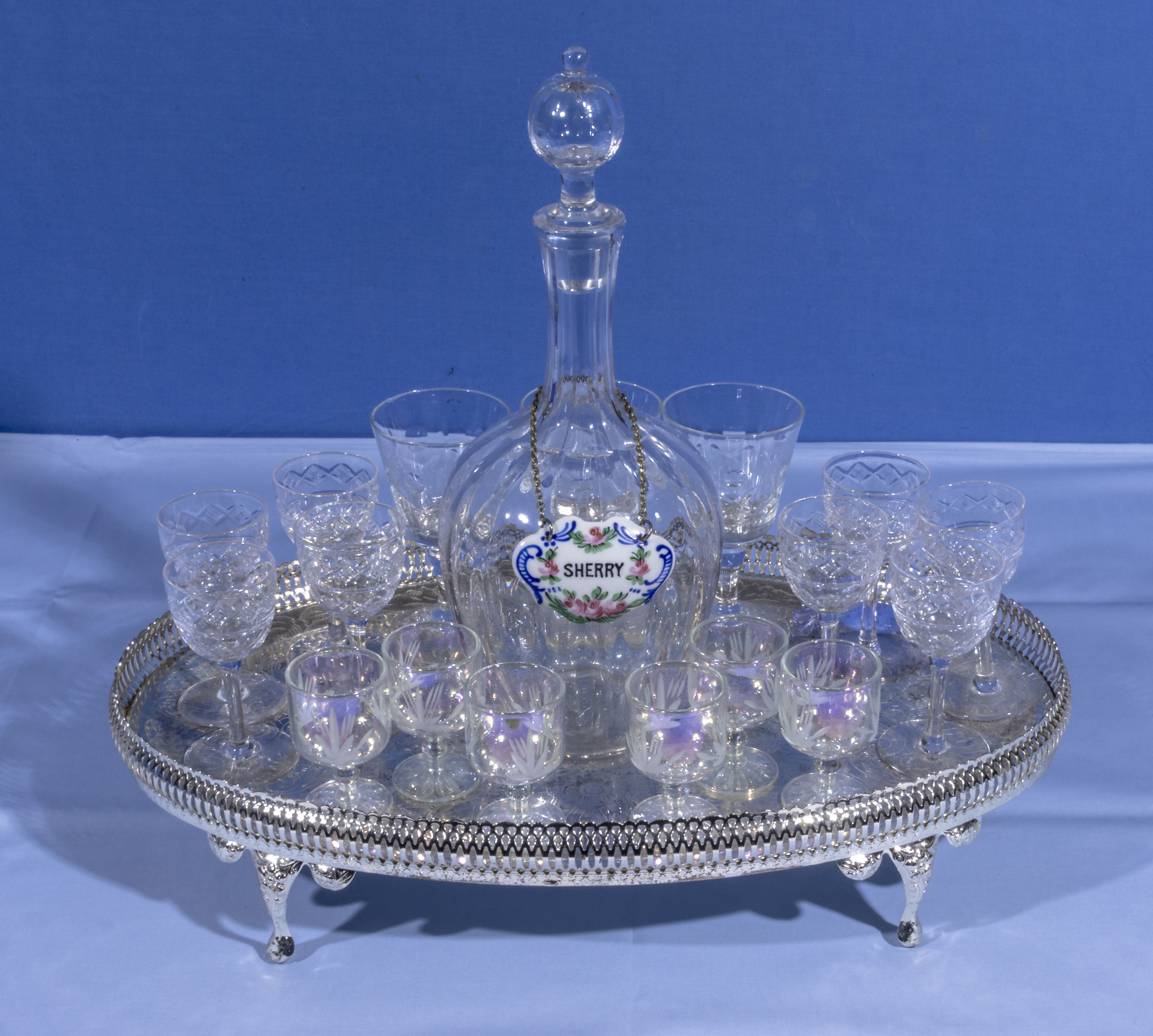 A selection of crystal port and sherry glasses together with a decanter and tray