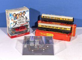 Two boxed Hornby carriages together with Fawlty Towers boxed set DVD's and a Batman car