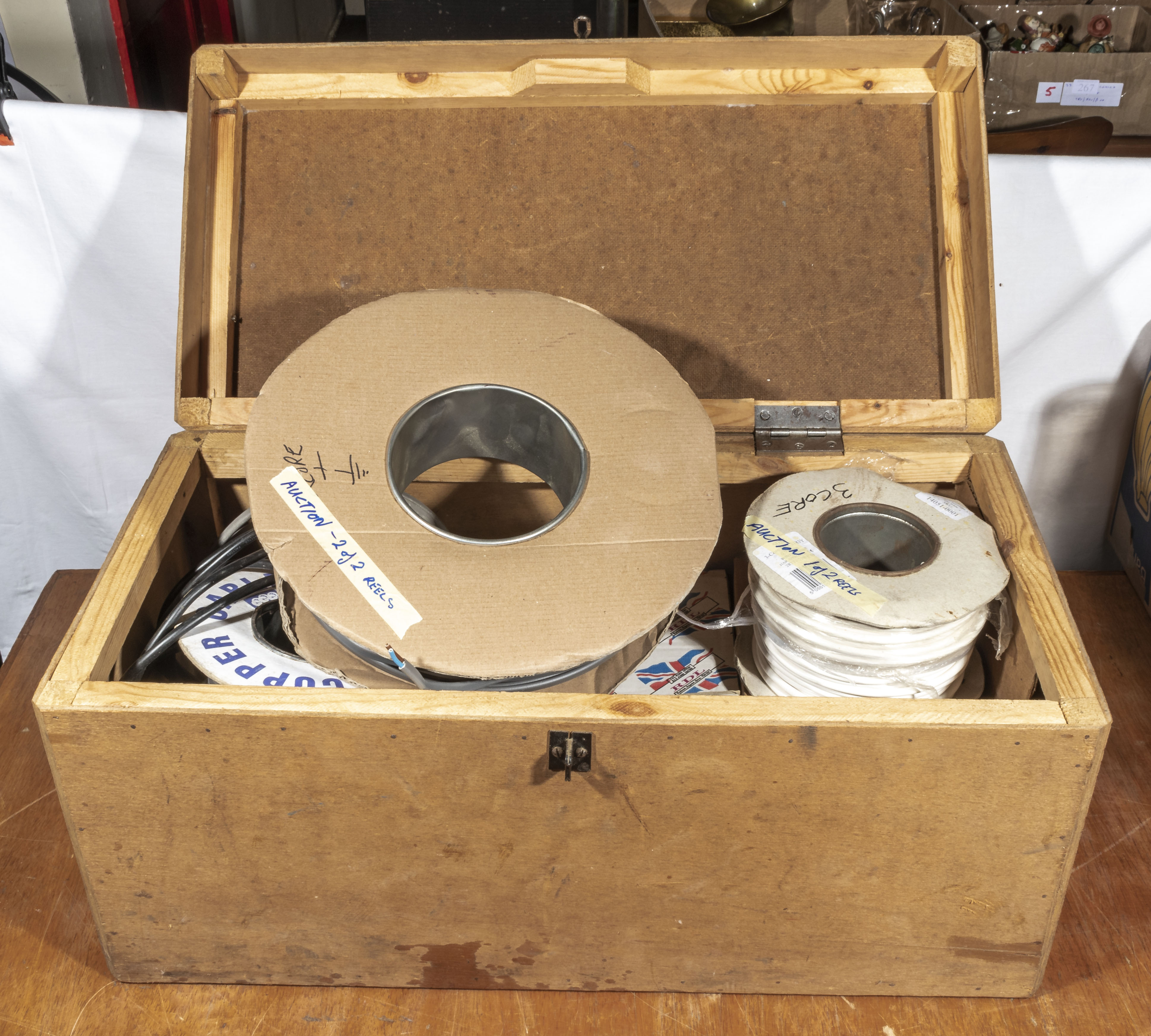 Wooden box containing reels of electric cable