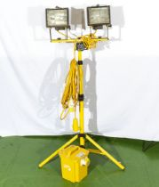A pair of 115V halogen lights on foldable stand with 2 outlet 230/115volt transformer plus extension