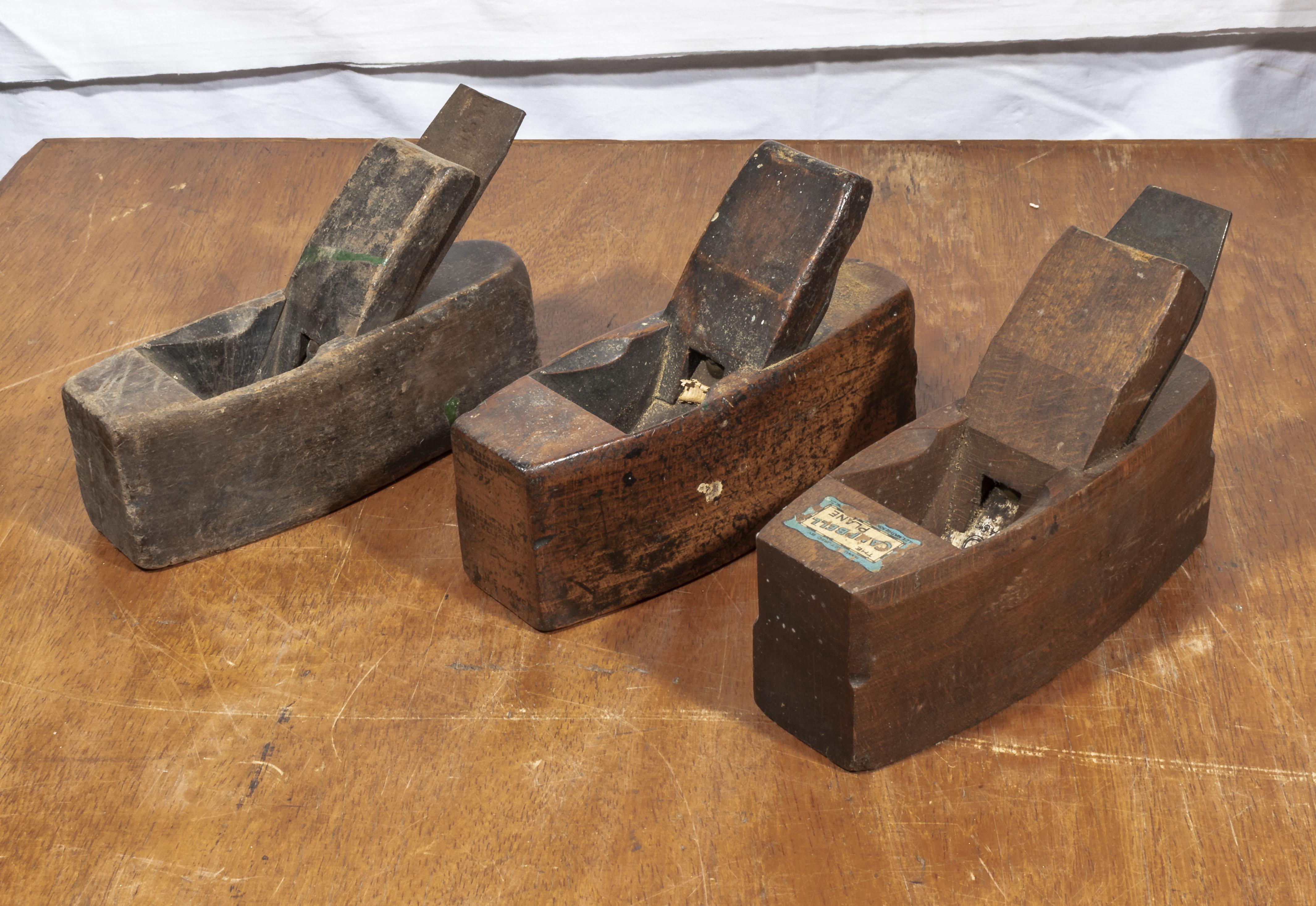 Three vintage wooden planes