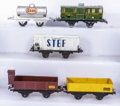 French Hornby O Gauge Esso Wagon, Luggage Van, Refrigerated Wagon, Cattle Wagon, and an Open Wagon