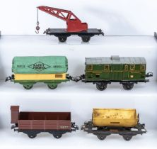 French Hornby O Gauge Crane Truck, Covered Wagon, Luggage Van, Cattle Wagon and a Tipping Wagon,
