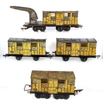 Vintage French JEP O gauge Relief Wagon Bogie together with three Wagon Bogies