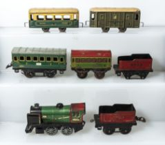 French Hornby clockwork engine 3615 together with two tenders, passenger car and three other small